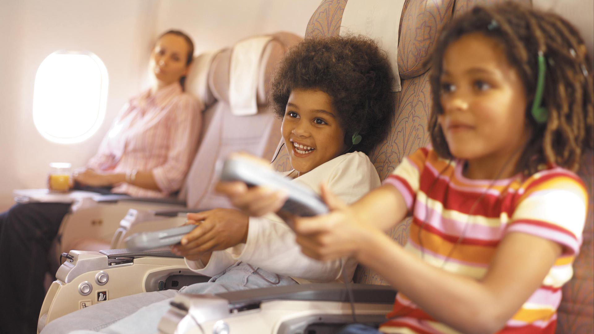 Two Kids Playing Games on Airplane